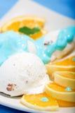 Ice cream and oranges dessert Stock Image