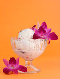 Ice cream and orchids Stock Photos