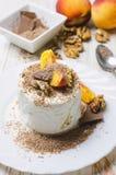 Ice cream with peach, chocolate and nuts. Ice cream with peach, chocolate and nuts on white plate Stock Photo