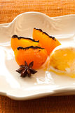 Ice cream and persimmon Stock Images