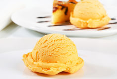 Ice cream and piece of sponge cake Royalty Free Stock Images