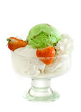 Ice cream pistacho. Ice cream, strawberries. pistachio ice-cream royalty free stock photography