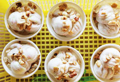 Ice cream in a plastic cup. Ice in a yellow plastic basket royalty free stock photos