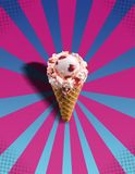 Ice Cream POP!. Image of an ice cream cone on a pop art pink and blue background royalty free stock photo