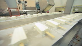 Ice cream production line. Food processing plant. Ice cream manufacturing. Ice cream production line. Food factory. Food processing plant. Vanilla ice cream stock footage