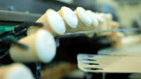 Ice cream production line. Row of ice cream on conveyor line. Food factory stock video footage