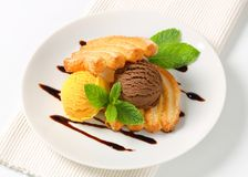 Ice cream with puff pastry biscuits Royalty Free Stock Images