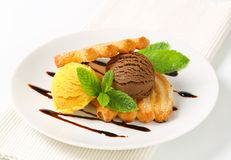 Ice cream with puff pastry biscuits Stock Images