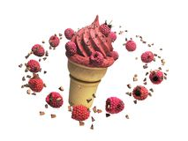ice cream with raspberries and chocolate crumbs in a waffle cup Stock Photo