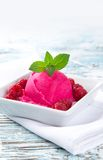 Ice cream with raspberries Stock Images