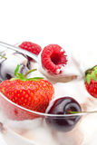 Ice cream, raspberries, strawberries and spoon Royalty Free Stock Images