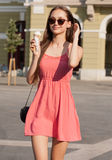 Ice cream refreshment. Beautiful young brunette woman having ice cream refreshment in summer sunshine Stock Photography