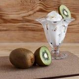 Ice cream and ripe kiwis Royalty Free Stock Photography