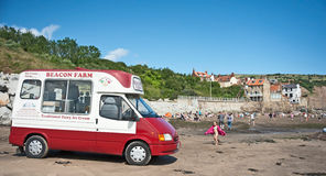 Ice cream at Robin Hood's Bay. Ice cream van on the beach at Robin Hood's Bay a popular resort in East Yorkshire Royalty Free Stock Image