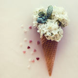 Ice cream's imitation in waffle cone decorated mint leaves. hydrangea flowers in waffle cone with mint leaves. Stock Photography