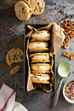 Ice cream sandwiches with chocolate chip cookies. Ice cream sandwiches with nuts and caramel and chocolate chip cookies overhead shot royalty free stock image