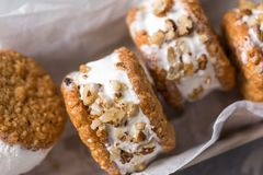 Ice cream sandwiches. With nuts and wholegrain cookies. Homemade vanilla and walnuts   close up stock image