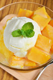 Ice cream scoop with fresh mango. Stock Images