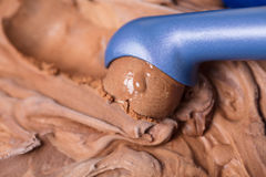 Ice cream scoop makes chocolate ball Stock Photos