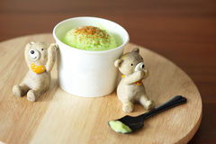 Ice cream scoop with miniature bear on wooden plate. Ice cream scoop with miniature bear doll on wooden plate stock image