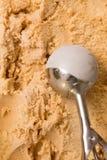 Ice cream scoop over ice cream Royalty Free Stock Photo