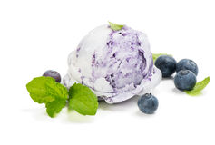Ice Cream Scoops with Blueberry. Blueberry ice cream fresh berries decorated with leaves of mint on white background stock photos