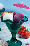 Ice-cream scoops with fresh berries on the beach, summer vacatio Royalty Free Stock Photo