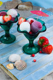 Ice-cream scoops with fresh berries on the beach, summer vacatio Royalty Free Stock Photography