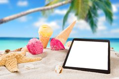 Ice cream scoops on sandy beach Royalty Free Stock Images