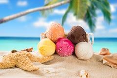 Ice cream scoops on sandy beach stock photos