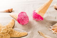 Ice cream scoops on sandy beach. Royalty Free Stock Photos