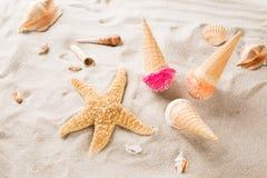 Ice cream scoops on sandy beach. Royalty Free Stock Image
