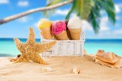 Ice cream scoops on sandy beach. Royalty Free Stock Photo