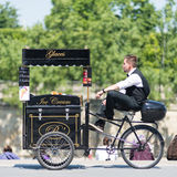 Ice cream seller with bicycle. Stock Photo