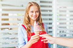 ice cream seller giving ice cream to a cu royalty free stock photography