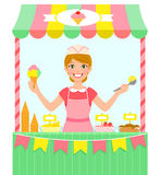 Ice cream seller. Happy young woman selling ice cream in a stall Royalty Free Stock Photography