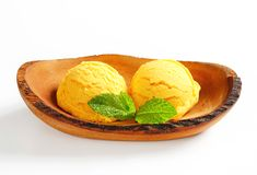 Ice cream served in natural wood bowl Royalty Free Stock Image
