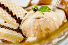 Ice cream served in restaurant with waffle Royalty Free Stock Images
