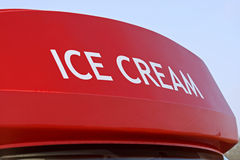 Ice cream sign on top of ice cream van. In summer royalty free stock photography