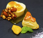 Ice cream, sorbet and pastry dessert. Ice cream, pineapple and mango sorbet and pastry dessert with candied almonds and hazelnuts Stock Photos