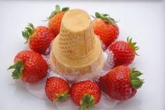Ice cream spilt on strawberries royalty free stock photos