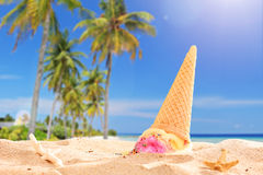 Ice cream splashed in the sand on a beach Royalty Free Stock Images