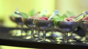 Ice cream. Spread cream waiters standing on spacing stock video