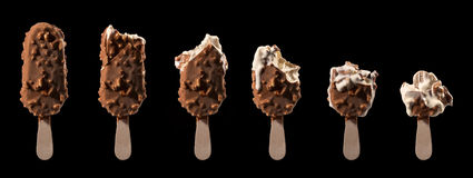 Ice cream stick chocolate vanilla and almonds Royalty Free Stock Image