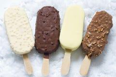 Ice cream on stick in ice. Closeup Stock Photo