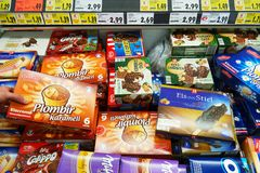 Ice cream in a Store. GERMANY - DECEMBER 2016: Freezer filled with varied packings of ice lolly in a Kaufland Hypermarket Royalty Free Stock Photos
