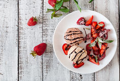 Ice cream with strawberries and chocolate Royalty Free Stock Images