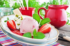 Ice cream and strawberries Stock Photography