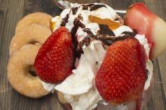 Ice cream with strawberries. Helado con frutas,donuts Stock Photo