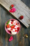 Ice cream with strawberries and rose petals. Stock Image